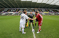 Pictured: Referees with team captains greeting each other before kick off Danny Dyer (R) and Adam Woodyatt (L). Sunday, 01 June 2014<br /> Re: Celebrities v Celebrities football game organised by Sellebrity Scoccer, in aid of Swansea City Community Trust, at the Liberty Stadium, south Wales.