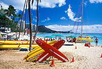 Catamarans, surfboards, blue waters, white sand beach and a view of Diamond Head. Just another day for those vacationing on Waikiki Beach.
