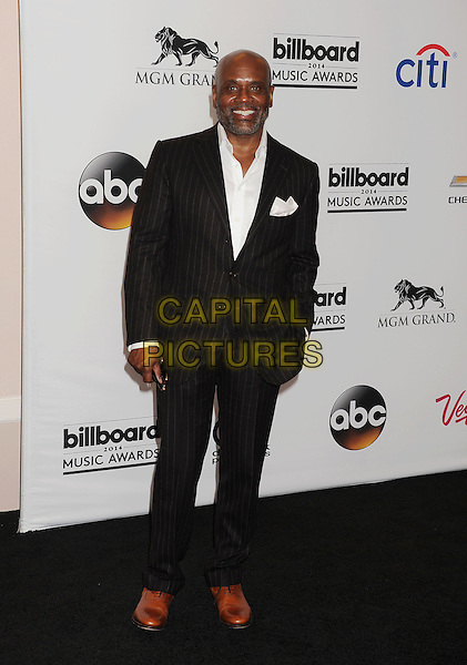LAS VEGAS, CA- MAY 18: Producer/music executive L.A. Reid poses in the press room at the 2014 Billboard Music Awards at the MGM Grand Garden Arena on May 18, 2014 in Las Vegas, Nevada.<br /> CAP/ROT/TM<br /> &copy;Tony Michaels/Roth Stock/Capital Pictures