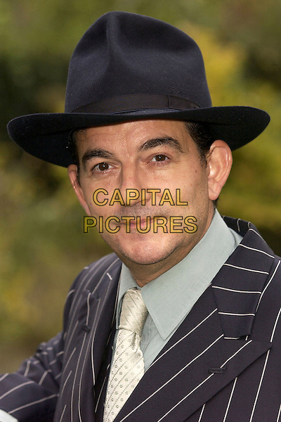 "JOHN ALTMAN.Photocall for the production of ""Kiss Me Kate"" at The Churchill Theatre, Bromley, Kent, 2nd November 2004..portrait headshot bowler hat.Ref: FIN.www.capitalpictures.com.sales@capitalpictures.com.©Steve Finn/Capital Pictures ."