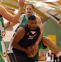 Heat guard BJ Anthony is fouled by Chris Reay during the NBL match between Manawatu Jets and Harbour Heat at Arena Manawatu, Palmerston North, New Zealand on Saturday 17 April 2010. Photo: Dave Lintott / lintottphoto.co.nz