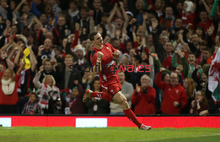 Wales wing George North celebrates scoring the first try of the match.<br /> Dove Men Series 2014<br /> Wales v Fiji<br /> Millennium Stadium<br /> 15.11.14<br /> ©Steve Pope-SPORTINGWALES