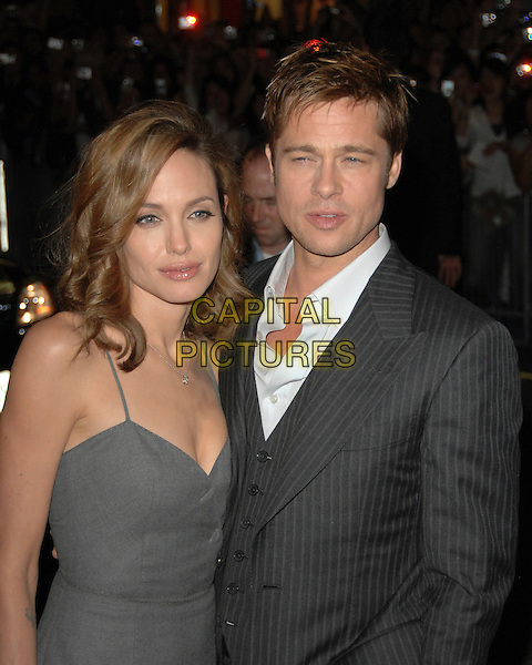 "BRAD PITT & ANGELINA JOLIE .At ""The Assassination of Jesse James by the Coward Robert Ford"" Premiere during the 2007 Toronto International Film Festival held at the Elgin Theatre, Toronto, Ontario, Canada, 08 September 2007. .half length couple grey dress waistcoat jacket pinstripe suit waistcoat three-piece three piece 3 3-piece.CAP/TL.©Tony Lee/Capital Pictures."