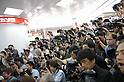 Photographers gather at an event for the release of Apple Computer's iPhone in Japan which will be distributed by mobile carrier SoftBank. 11 July, 2008. (Erika Aragon/JapanToday/Nippon News)