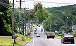 WOLCOTT CT. - 05 August 2020-080520SV02-A tree hangs in primary powerlines over Wolcott Road in Wolcott Wednesday.<br /> Steven Valenti Republican-American