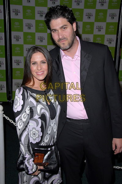 SOLEIL MOON FRYE & JASON GOLDBERG.16th Annual Environmental Media Association Awards Gala held at the Wilshire Ebell Theatre,Los Angeles, California, USA..November 8th, 2006.Ref: ADM/CH.full length black suit jacket grey gray floral print dress patten.www.capitalpictures.com.sales@capitalpictures.com.©AdMedia/Capital Pictures. *** Local Caption *** ..