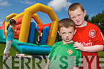 FUN DAY: Cousins Gary and Michael Flynn enjoyed the bouncy castles at the Connect 7 Balloonagh Family fun day on Friday..