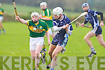 IT Tralee's Giles O'Grady and Kerry's Daniel Collins in action in the Waterford Crystal Cup at Abbeydorney on Sunday..