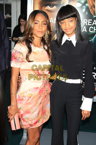 Jada Pinkett Smith &amp; Willow Smith<br /> The New York Premiere of &quot;After Earth&quot; at the Ziegfeld Theatre, New York, NY., USA.<br /> May 29th, 2013<br /> half length black shirt belt cuffs collar trousers floral print pink pattern dress mother mom mum daughter clutch bag<br /> CAP/LNC/TOM<br /> &copy;LNC/Capital Pictures