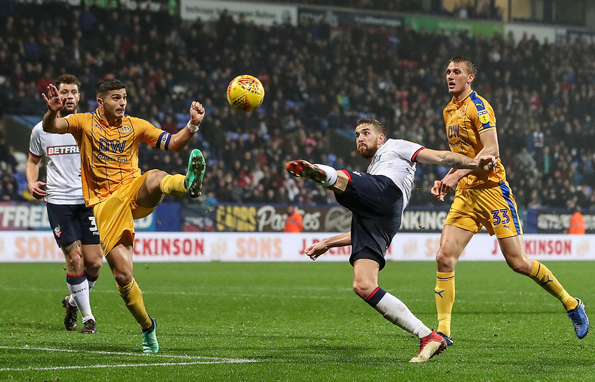 Bolton Wanderers' Mark Beevers competing with Wigan Athletic's Sam Morsy<br /> <br /> Photographer Andrew Kearns/CameraSport<br /> <br /> The EFL Sky Bet Championship - Bolton Wanderers v Wigan Athletic - Saturday 1st December 2018 - University of Bolton Stadium - Bolton<br /> <br /> World Copyright © 2018 CameraSport. All rights reserved. 43 Linden Ave. Countesthorpe. Leicester. England. LE8 5PG - Tel: +44 (0) 116 277 4147 - admin@camerasport.com - www.camerasport.com