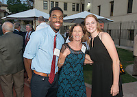 Jay Miller '18, Beth (Kartub) Raff '82 and Alida Beck '15. Alumni, family, staff and students at the Occidental College Athletics Hall of Fame event, part of Homecoming weekend, Oct. 24, 2014 on Patterson Field. (Photo by Marc Campos, Occidental College Photographer)