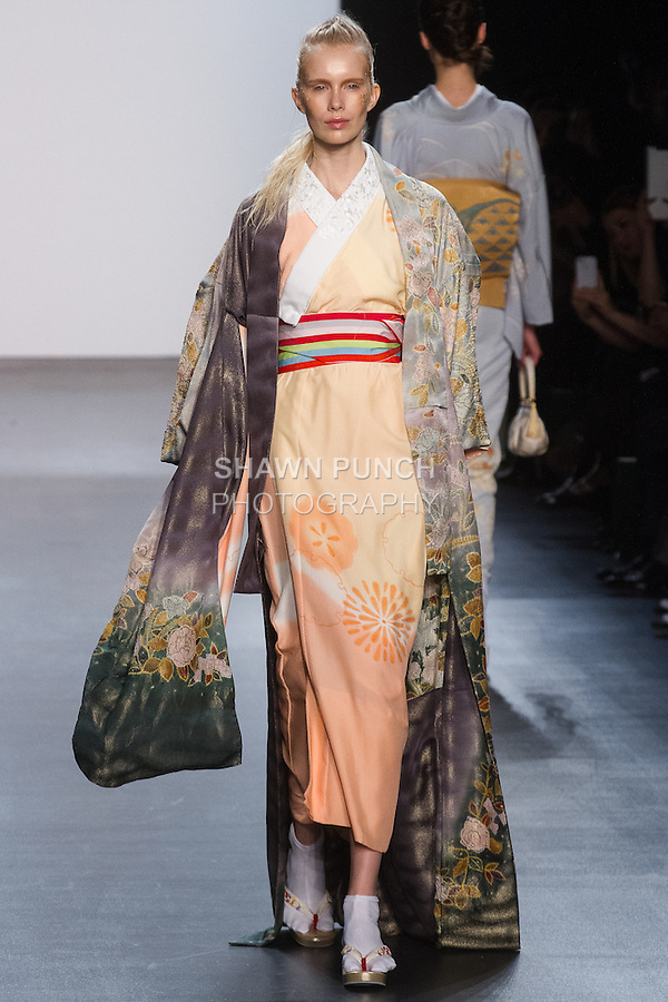 """Model walks runway in a """"Happy in the room"""" silk kimono from the Hiromi Asai Fall Winter 2016 """"Spirit of the Earth"""" collection by Hiromi Asai & Kimono Artisan Kyoto, presented at NYFW: The Shows Fall 2016, during New York Fashion Week Fall 2016."""