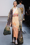 "Model walks runway in a ""Happy in the room"" silk kimono from the Hiromi Asai Fall Winter 2016 ""Spirit of the Earth"" collection by Hiromi Asai & Kimono Artisan Kyoto, presented at NYFW: The Shows Fall 2016, during New York Fashion Week Fall 2016."