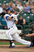 Round Rock Express first baseman Mike Bianucci #33 swings during the Pacific Coast League baseball game against the New Orleans Zephyrs on April 30, 2012 at The Dell Diamond in Round Rock, Texas. The Zephyrs defeated the Express 5-3. (Andrew Woolley / Four Seam Images)