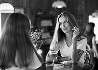 Actress Barbara Bach having lunch with her sister, Malibu California, 1977. Photo by John G. Zimmerman