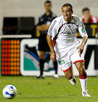New England Revolution midfielder Jose Cancela (7) dribbles the ball up the field.  The Chicago Fire defeated the New England Revolution 2-1 in the quarterfinals of the U.S. Open Cup at Toyota Park in Bridgeview, IL on August 23, 2006...