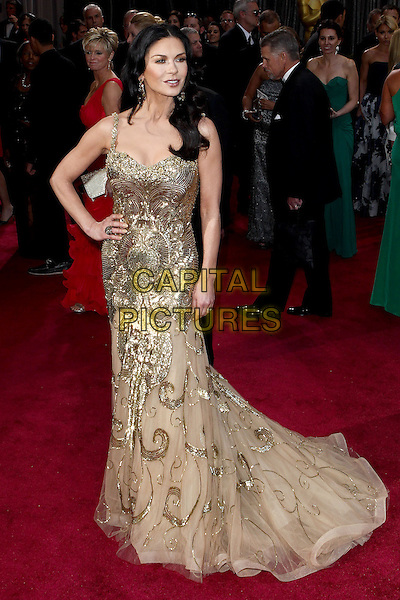 Catherine Zeta-Jones (wearing Zuhair Murad).2013 Vanity Fair Oscar Party following the 85th Academy Awards held at the Sunset Tower Hotel, West Hollywood, California, USA..February 24th, 2013.oscars full length gold sequins sequined dress hand on hip metallic sheer tulle .CAP/ADM/SLP/DOW.©Dowling/StarlitePics/AdMedia/Capital Pictures
