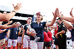 DES MOINES, IA - AUGUST 20: USA's captain Julie Inkster carries the Solheim Cup after the closing ceremony and gives high fives to fans Sunday at the 2017 Solheim Cup in Des Moines, IA. (Photo by Dave Eggen/Inertia)