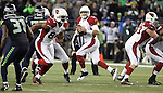 Arizona Cardinals quarterback Carson Palmer (3) looks to pass against the Seattle Seahawks at CenturyLink Field in Seattle, Washington on November 15, 2015. The Cardinals beat the Seahawks 39-32.   ©2015. Jim Bryant photo. All Rights Reserved.