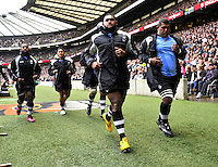Twickenham, England. Fiji players warm up during the QBE Internationals England v Fiji at Twickenham Stadium on 10 November. Twickenham, England, 2012