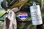 Apr. 30 - BANGKOK, THAILAND: A Thai soldier with heart shaped Thai flag and a tear gas grenade on his chest. The Red Shirts moved one of their barricades in the Sala Daeng Intersection in Bangkok Friday In one of the first positive moves to take place since the Red Shirts occupied central Bangkok in early April. The barricade was moved far enough back to open one lane of traffic on  Ratchadamri Street to allow ambulance access to King Chulalongkorn Memorial Hospital, a large hospital at the intersection. Many of the patients in the hospital have been moved to other hospitals because a group of Red Shirts entered the hospital Thursday looking for Thai security personnel, who were not in the hospital. The stand off between the Red Shirts and the government enters its third month in May. The Red Shirts continue to call for Thai Prime Minister Abhisit Vejjajiva to step down and dissolve parliament and demand the return of ousted Prime Minister Thaksin Shinawatra.   PHOTO BY JACK KURTZ