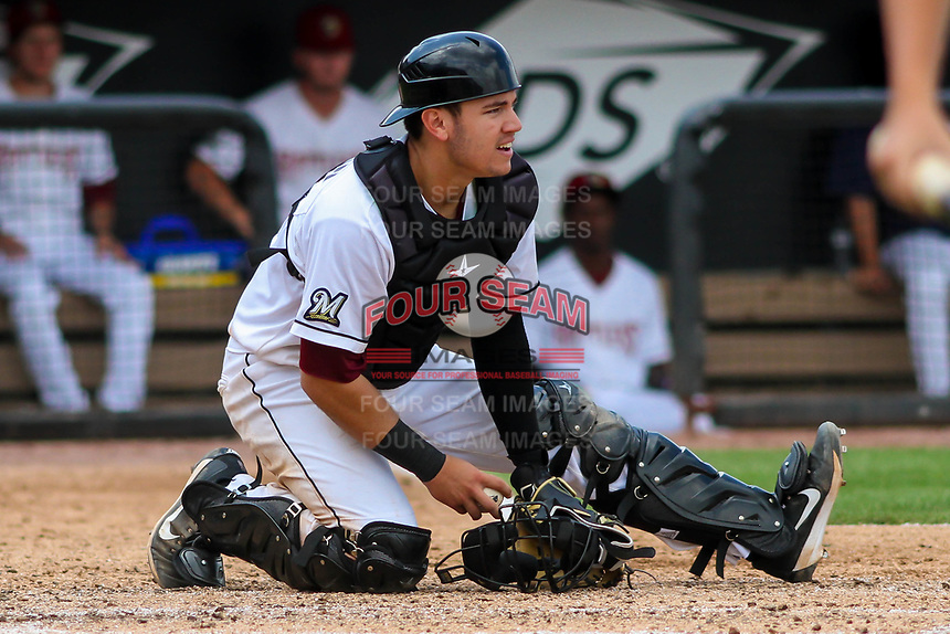 Wisconsin Timber Rattlers catcher KJ Harrison (24) during a Midwest League game against the Bowling Green Hot Rods on July 23, 2018 at Fox Cities Stadium in Appleton, Wisconsin. Wisconsin defeated Bowling Green 5-3. (Brad Krause/Four Seam Images)