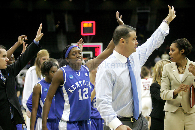 After their loss to third-seed Oklahoma Sooners, UK head coach Matthew Mitchell, senior guard Lydia Watkins and members of the women's hoops leave the floor of the Spring Center on Tuesday, March 30, 2010 during the Kansas City Regional Final in Kansas City, Mo. The Sooners defeated the Cats, 88-68. Photo by Allie Garza | Staff