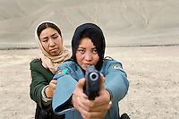 In Bamiyan, Afghanistan a small select group of women train as police officers and practice their target shooting in the local hills. This is an unusual profession for women from this country where they are usually made to wear burkas and discouraged to work outside of the home.