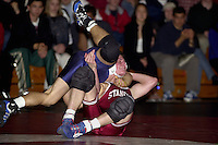 Freshman Nathan Peterson wrestles against Tommy Schurkamp of UC Davis on January 19, 2001 at Burnham Pavilion.