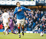 Nikica Jelavic points to the badge after scoring for Rangers