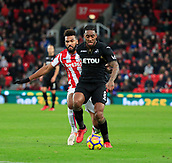 2nd December 2017, bet365 Stadium, Stoke-on-Trent, England; EPL Premier League football, Stoke City versus Swansea City; Leroy Fer of Swansea City tries to shield the ball from Eric Maxim Choupo-Moting of Stoke City