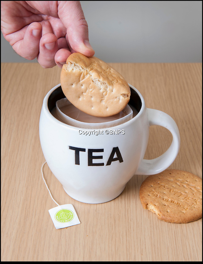 BNPS.co.uk (01202 558833)<br /> Pic: PhilYeomans/BNPS<br /> <br /> Finally...An end to the Tea-break terror...<br /> <br /> Catch that...<br /> <br /> Tea drinkers are rejoicing after a nifty device designed to catch crumbs left by dunking biscuits in your brew hit the shelves.<br /> <br /> Dad of two Andrew Tinsley solved the age-old problem with a canny mesh pouch which sits inside a mug of tea collecting any unwanted biscuit bits that might float off during dunking.<br /> <br /> And should your Digestive or Rich Tea become too soggy and break off altogether this cheap and cheerful gadget will guarantee drinkers are not left with a heap of biscuity sludge at the bottom of their cup.<br /> <br /> Entrepreneur Andrew, 49, dreamed up the product, called the Cookie Catcher, after watching family members lose their sodden biscuits in their tea after dunking them for too long during Christmas celebrations last year.