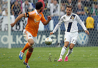 CARSON, CA - DECEMBER 01, 2012:  David Beckham (23) of the Los Angeles Galaxy chips over a cross past Brad Davis (11) of the Houston Dynamo during the 2012 MLS Cup at the Home Depot Center, in Carson, California on December 01, 2012. The Galaxy won 3-1.