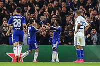 Willian of Chelsea (2nd right) and Cesc Fabregas of Chelsea (2nd left) celebrate the opening goal after an own goal puts Chelsea 1-0 ahead during the UEFA Champions League Group match between Chelsea and Dynamo Kyiv at Stamford Bridge, London, England on 4 November 2015. Photo by David Horn.