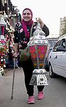 "A picture taken on May 8, 2018 show an Egyptian woman carries a traditional lantern known in Arabic as ""Fanous"", at a market ahead of the holy Muslim month of Ramadan in Cairo, Egypt. Ramadan is sacred to Muslims because it is during that month that tradition says the Koran was revealed to the Prophet Mohammed. The fast is one of the five main religious obligations under Islam. Muslims around the world will mark the month, during which believers abstain from eating, drinking, smoking and having sex from dawn until sunset. Photo by Amr Sayed"