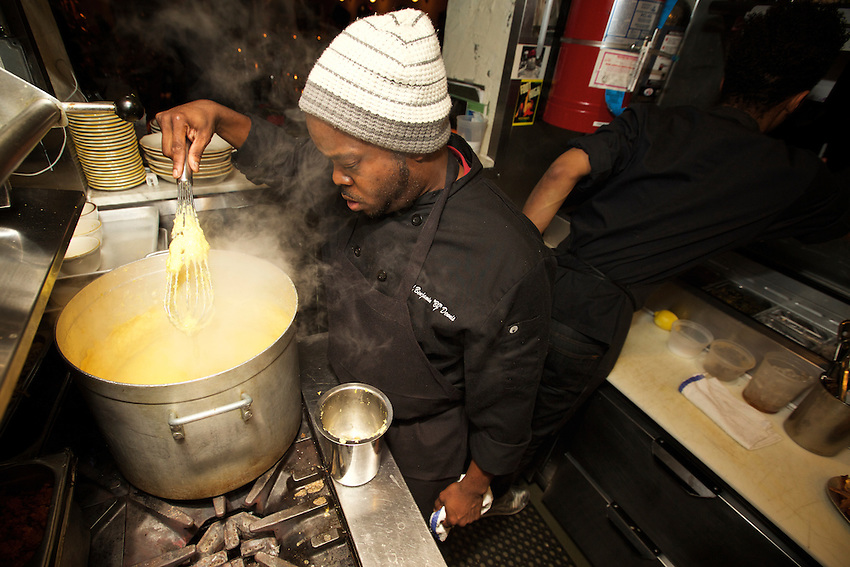 BROOKLYN, NY - JANUARY 15, 2016: Charleston Chef BJ Dennis cooking in the kitchen at Williamsburg's Loosie's Kitchen.<br /> <br /> CREDIT: Clay Williams<br /> <br /> &copy; Clay Williams / claywilliamsphoto.com