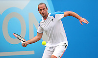 11.06.13 London, England. Xavier Malisse in action against Juan Martin Del Potro during the The Aegon Championships from the The Queen's Club in West Kensington.