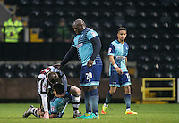 Adebayo Akinfenwa of Wycombe Wanderers keeps an eye on Matt Tootle of Notts Co on Scott Kashket of Wycombe Wanderers during the Sky Bet League 2 match between Notts County and Wycombe Wanderers at Meadow Lane, Nottingham, England on 10 December 2016. Photo by Andy Rowland.