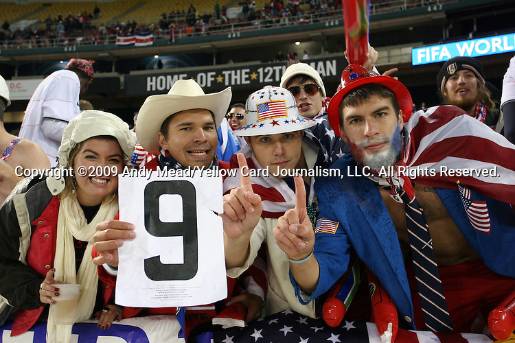 "14 October 2009: U.S. fans hold up a ""9"" honoring U.S. player Charlie Davies who was seriously injured in an automobile accident two days earlier. The United States Men's National Team played the Costa Rica Men's National Team at RFK Stadium in Washington, DC in the Hexagonal, the final CONCACAF round, a FIFA 2010 South Africa World Cup Qualifier."