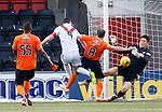 Japanese keeper Eiji Kawashima blocks the goal bound effort fom Airdrie captain Marc Fitzpatrick