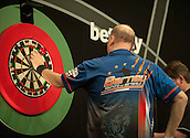09.04.2015. Sheffield, England. Betway Premier League Darts. Matchday 10.  Raymond van Barneveld [NED] retrieves his darts during his game with Phil Taylor [ENG]