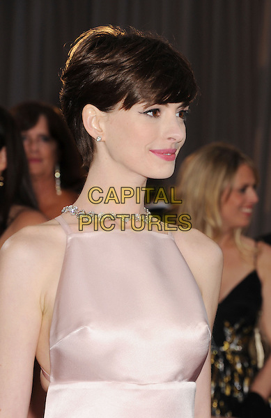 Anne Hathaway (wearing Prada).85th Annual Academy Awards held at the Dolby Theatre at Hollywood & Highland Center, Hollywood, California, USA..February 24th, 2013.oscars half length pink sleeveless silk satin profile  jewel encrusted embellished dress.CAP/ROT/TM.©Tony Michaels/Roth Stock/Capital Pictures