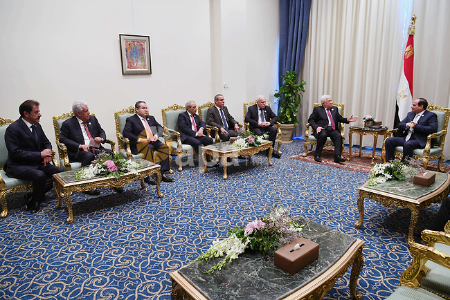 Palestinian President Mahmoud Abbas meets with Egyptian President Abdel-Fattah al-Sisi on the sidelines of the World Youth Forum in Sharm El Sheikh, Egypt, on Nov. 6, 2017. Photo by Thaer Ganaim