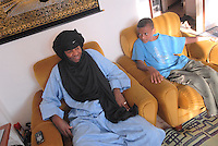 """- a small community of Tuareg, the legendary """"blue men"""" of Sahara, coming from, Niger has settled in Pordenone, town of Italian northeast, being able to achieve a good degree of integration although in the respect of their traditional culture; Mohamed Abety with Sidi, son of the friend Haddo Oubana El Hadji in the home where they live....- una piccola comunità di Tuareg, i leggendari """"uomini blu"""" del Sahara, provenienti dal Niger, si sono stabiliti a Pordenone, città del nord-est italiano, riuscendo a conseguire un buon grado di integrazione pur nel rispetto della loro cultura tradizionale; Mohamed Abety con Sidi, figlio dell'amico Haddo Oubana El Hadji nella casa dove abitano"""