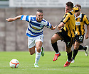 Morton's Dougie Imrie holds off East Fife's Ross Brown.