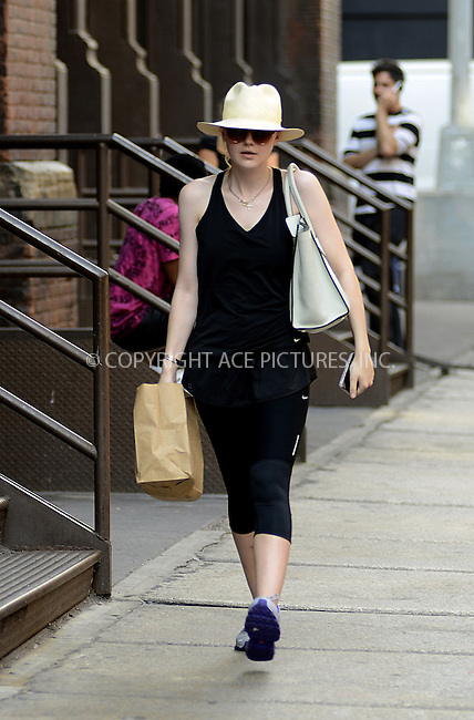 WWW.ACEPIXS.COM....September 7 2012, New York City....Actress Dakota Fanning rocks a Panama hat and Ray Bans with gym kit as she strolls around Soho on September 7 2012 in New York City......By Line: Curtis Means/ACE Pictures......ACE Pictures, Inc...tel: 646 769 0430..Email: info@acepixs.com..www.acepixs.com