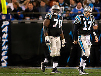 Carolina Panthers quarterback Jake Delhomme (17) walks off the field with Travelle Wharton (70) against the Arizona Cardinals during the NFC Divisional Playoff football game at Bank of America Stadium, in Charlotte, NC. Arizona defeated the Carolina Panthers 33-13.