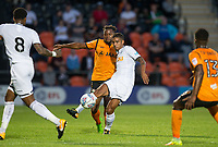 Kyle Naughton of Swansea City battles Jean Akpa-Akpro of Barnet during the 2017/18 Pre Season Friendly match between Barnet and Swansea City at The Hive, London, England on 12 July 2017. Photo by Andy Rowland.