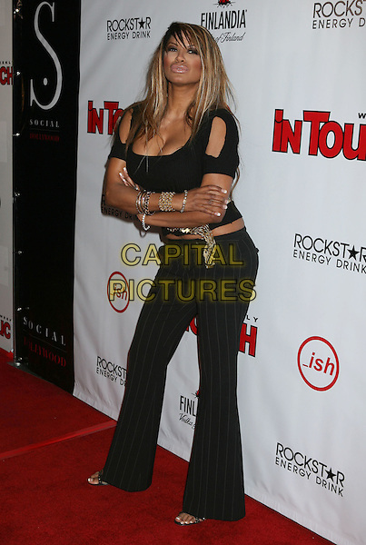 TRACI BINGHAM.In Touch Weekly's Summer Stars Party 2008 held at Social Hollywood, Hollywood, California, USA,  .22 May 2008..full length black top trousers cleavage arms folded.CAP/ADM/MJ.©Michael Jade/Admedia/Capital Pictures
