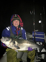 BNPS.co.uk (01202 558833)<br /> Pic: ObanJones/BNPS<br /> <br /> Oban Jones with his catch<br /> <br /> An angler caught a potential British record sea bass - but had to throw it back due a controversial EU law.<br /> <br /> Oban Jones, 19, is adamant his whopping catch weighed over 20lbs, putting it above the 19lbs 9ozs record that has stood for 32 years.<br /> <br /> But he couldn't claim the title as he had to return the 3.5ft long fish because recreational anglers are banned from retaining even a single specimen at this time of year.<br /> <br /> The EU brought in the rule that runs from November 1 to December 31 when the over-fished species is breeding.